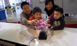 Family Touching Electricity Exhibit